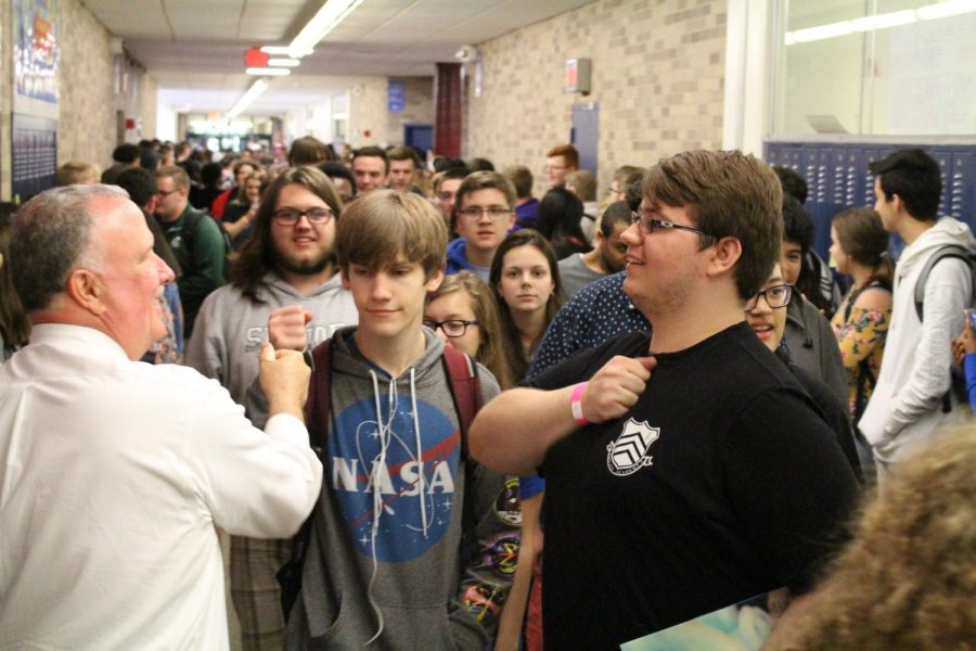 Science+teacher+Mr.+Cooper+fist-bumps+a+senior+in+celebration+during+the+clap-out+May+30.+Photo+courtesy+Ms.+Nimmerguth.+